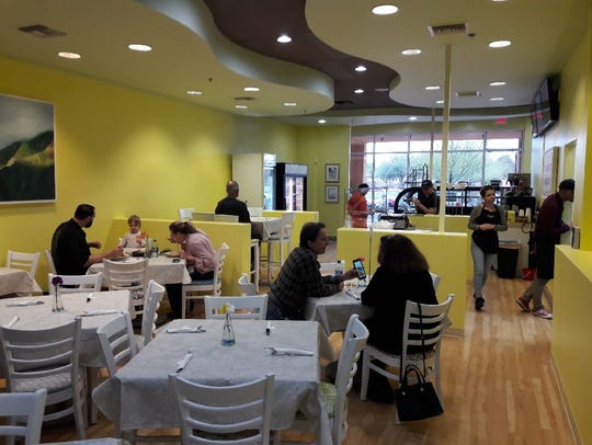 The brightly colored dining room inside Italian restaurant