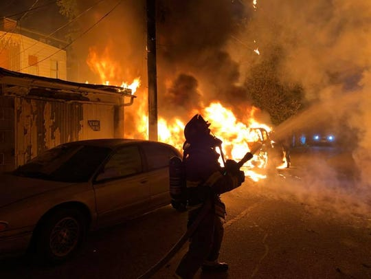 Fire engulfs a car and garage in the 500 block of Pennsylvania