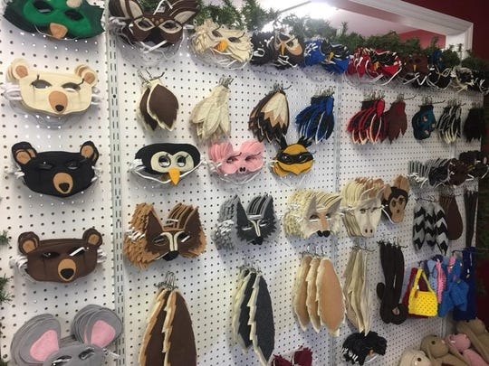 Felt masks on display at The Forest Faire.