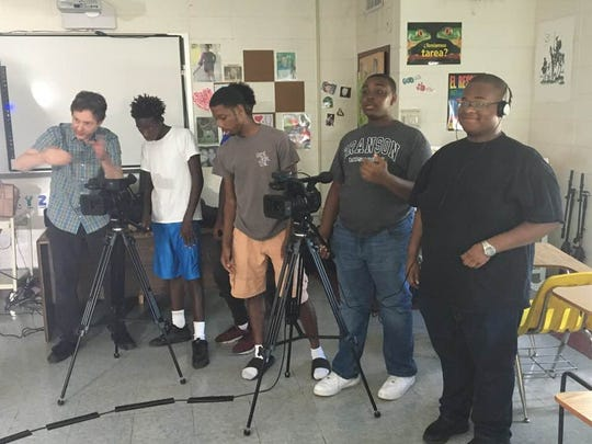 Documentary filmmaker Joe Davenport works with students participating in the Young Filmmakers' Workshop in the classroom.