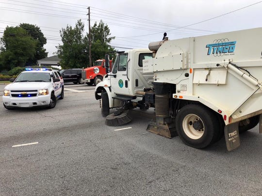 Greenville police officers and city sanitation crews worked to clear roughly 1,000 nails from South Pleasantburg Drive Tuesday morning.
