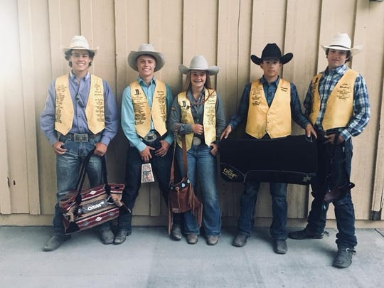 From left: Trent Watkins, Bailey Small, Shelby Dunning, Clayton Moore and Cole Bunting pose in photo of high schoolers from the California High School Rodeo Association's first district competing in the National High School Finals Rodeo in Rock Springs, Wyoming.