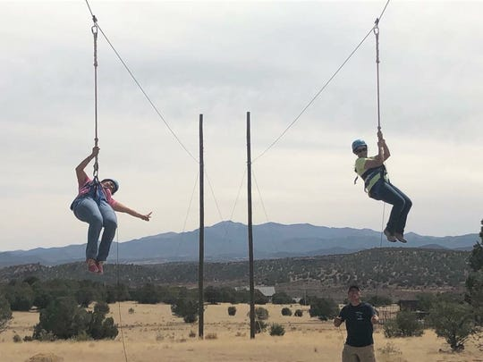 Zip lining is a fun way to have some adventure before going back to school.
