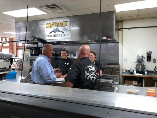 "John McGivern (left) films a scene for his show ""Around the Corner with John McGivern"" at Delafield's Daybreak Prime Meats and Deli. The episode featuring Delafield will air Feb. 7 on PBS."