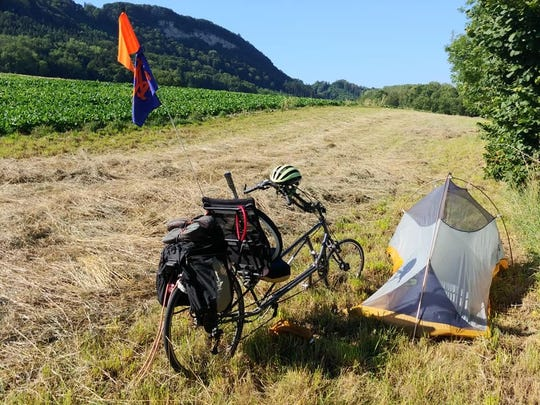 During his bike trip across Europe, Leon tennis coach Kevin Record slept in tents in random farm fields.