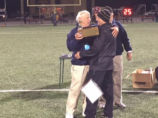 Provided  Dick Cerone, then chairman of Section V football, presents the sectional trophy to his son, Rob, after Greece Athena won the Class A title in 2016. Dick Cerone, then chairman of Section V football, presents the sectional trophy to his son, Rob, after Greece Athena won the Class A title in 2016.
