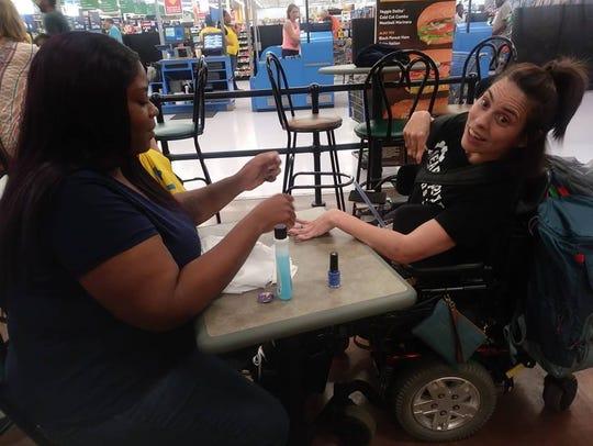 Walmart employee Ebony Harris painted a customer's