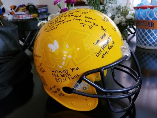 Teammates and coaches signed this helmet for Tanner