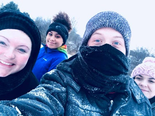 The Hunt family celebrates a snow day.