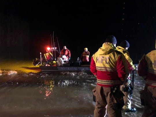 HFD and the Henderson City County Rescue Squad rescue two people trapped in a partially submerged vehicle (Jan. 27, 2019).