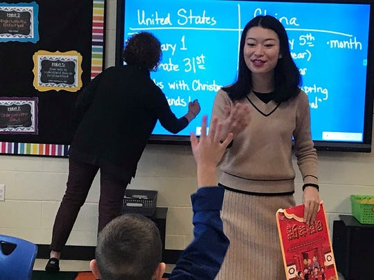 Sunny Wong, a teacher from China, answers questions from Christy Baxter's third-grade class at Spottsville Elementary School. (Feb. 5, 2019).