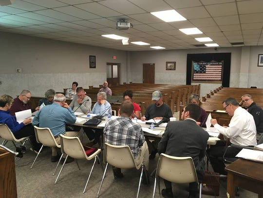 County magistrates and department heads sit down at