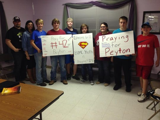 Youth at Beauregard Methodist Church made signs supporting Flowers