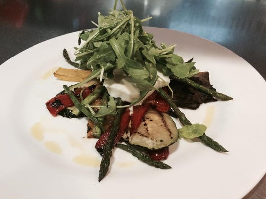 A dish with chicken, fresh mozzarella, and roasted red peppers from East Coast Cookery in Neptune. East Coast Cookery will have entertainment and drink specials Thanksgiving Eve.