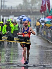 Scott Wietecha, of Hendersonville, wins the 14th Country Music Marathon in Nashville, Tenn., Saturday, April 27, 2013.