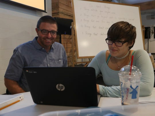 Grant Elementary School District Superintendent/principal and mentor Mike Freeman, left, works with Hannah Borg, 17, on a presentation about homeless teens Friday at the Catalyst Center in Redding.