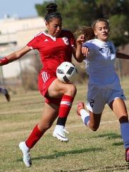 Valencia's Camila Orozco tries to win possession of