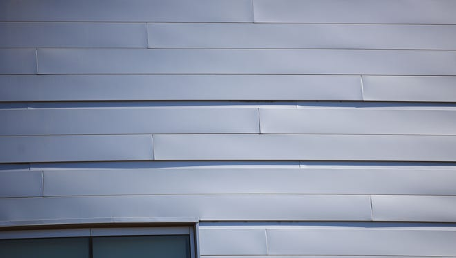 Denny Sanford Premier Center building Tuesday, Oct. 10, in Sioux Falls. Former construction manger Don Hennies says the panels on the building do not nest properly and that is why they protrude slightly from the building when they meet.