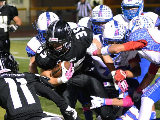 Oñate's Forest McKee plows his way through the Bulldawg