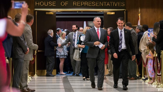 Florida House Speaker Richard Corcoran, center left, and other representatives walk out to meet members of the Senate in the rotunda between the two chambers at the close of the 2017 legislative session late Monday night, May 8, 2017 at the Florida Capitol in Tallahassee, Florida. (AP Photo/Mark Wallheiser)