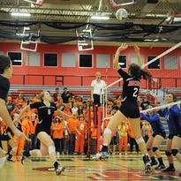 Rocori High School volleyball player Morgan Holthaus high fives her sister Elenor Holthaus on Thursday at Rocori.