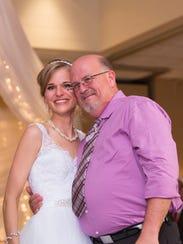 Greta Perske and Danny Daniels share a hug at her wedding