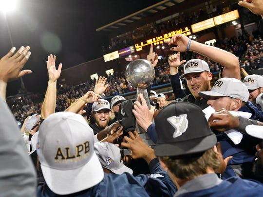 The York Revolution celebrate with the Atlantic League Championship trophy after winning the third game of the five-game Atlantic League Championship series Friday, Sept. 29, 2017, at PeoplesBank Park. The Revolution defeated the Long Island Ducks 3-2 to clinch the championship, their third overall and first since 2011.