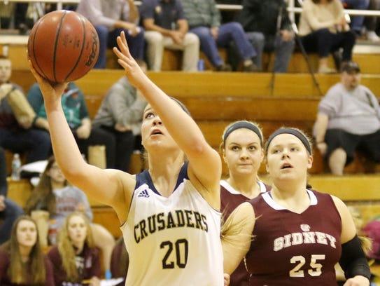 Notre Dame's Mia Herlan gets past Sidney defenders