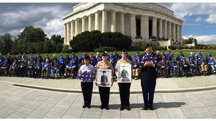 Participants of the Hudson Valley Honor Flight's 11th trip on April 2, near the Lincoln Memorial in Washington, D.C.