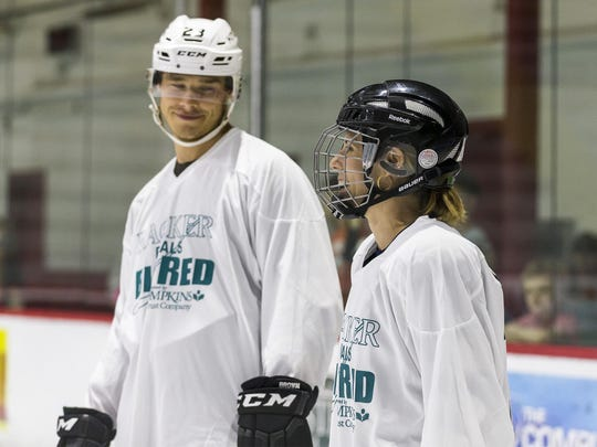 """Dustin Brown and his wife, Nicole, are pictured prior to the start of the second annual """"Racker Rivals Big Red"""" benefit hockey game on Saturday night at Lynah Rink. Dustin Brown scored three goals during the game; Nicole Brown scored in the shootout that followed regulation time."""