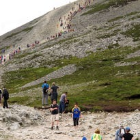 Climbers begin the final ascent on Croagh Patrick in County Mayo, Ireland. Every year, hundreds of thousands of people climb the holy mountain where the fifth century saint is said to have fasted for forty days and nights as he wrestled with demons and banished snakes from Ireland.