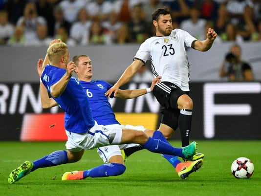 Germany's Kevin Volland and Finland's Paulus Arajuuri and Thomas Lam, from right,  challenge for the ball during a friendly soccer match between Germany and Finland in Moenchengladbach, Germany, Wednesday, Aug. 31, 2016. (AP Photo/Martin Meissner)