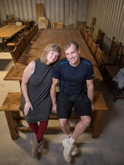 Mark and Helen Perrott sit on a bench at Mississippi