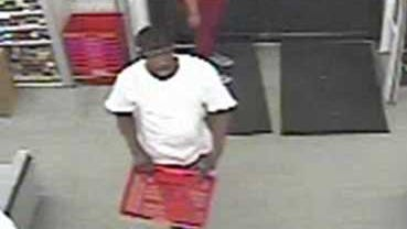 Photo shows the suspect entering the store.