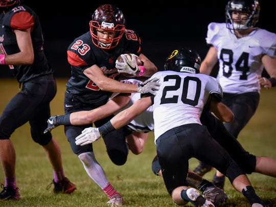 Rocori's Gunner Feldhege is brought down after a gains against Hutchinson's during the first half  Friday, Oct. 13, in Cold Spring.