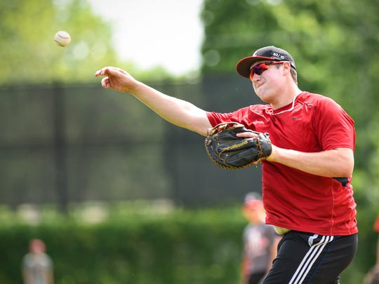 Rocori's Matthew Waletzko throws from first to home during infield practice Tuesday, June 12, in Cold Spring.