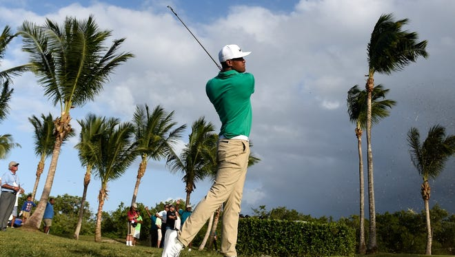 Tony Finau plays his second shot from the rough on the first playoff hole during the final round of the Puerto Rico Open at Coco Beach on March 27, 2016 in Rio Grande, Puerto Rico.