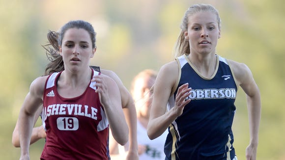 Asheville High senior Naomi Cartier (19) has committed to run college cross country and track for Boston College.