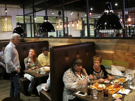 Owner Michael Hernandez, left, chats with guests at his new Public House restaurant and lounge that anchors Creekside Corners on the southeast corner of Goodlette-Frank and Immokalee roads in North Naples.