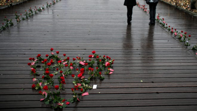 Roses  on the Pont des Arts in Paris on Feb. 14, 2014. Denmark's Spies Rejser travel company is encouraging Danes to travel to romantic places to increase the country's birth rate.