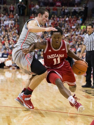 Indiana guard Kevin Ferrell drives past Ohio State guard Aaron Craft, left, who is one of the best on-the-ball defenders in the country.