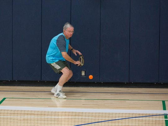 Paul Turner moves into hit a ball during a pickleball match at Meerscheidt Recreation Center, located at 1600 E. Hadley Ave.
