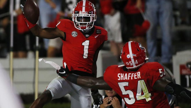 Oct 3, 2020; Athens, GA, USA; Georgia wide receiver George Pickens (1) celebrates after scoring a touchdown during the first half of an NCAA college football game between Georgia and Auburn in Athens, Ga., on Saturday, Oct. 3, 2020.  Mandatory Credit: Joshua L. Jones-USA TODAY NETWORK