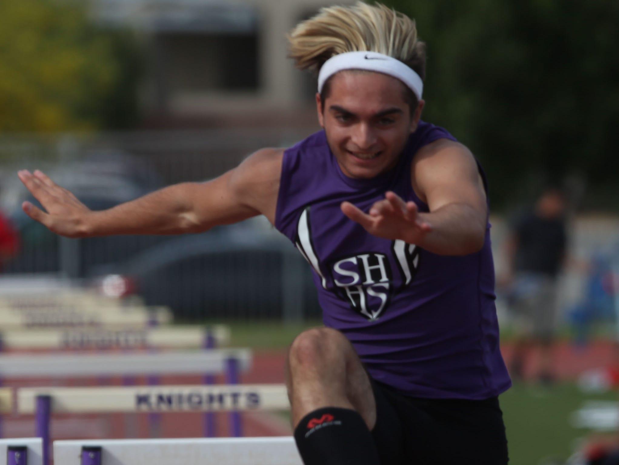 Shadow Hills High School's Gavin Palazzo wins the 100 meter hurdles against Rancho Mirage High School runners in Indio.