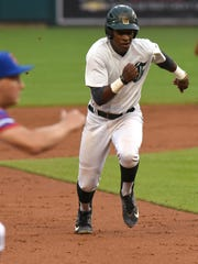 Birmingham Groves player Zavier Warren bolts for third base as a member of the East squad in Tuesday's high school all-star game at Comerica Park.