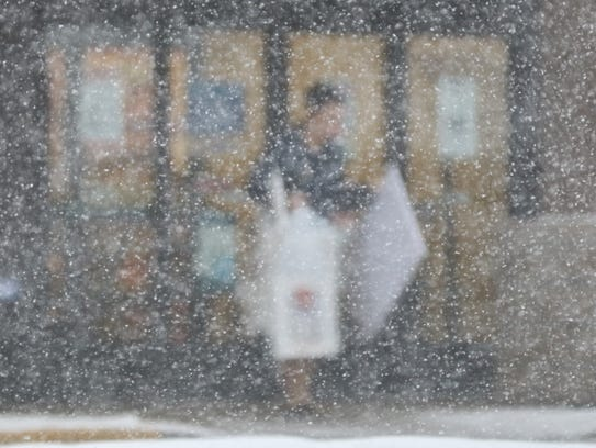 A shopper leaves Hobby Lobby on Route 46 in Woodland