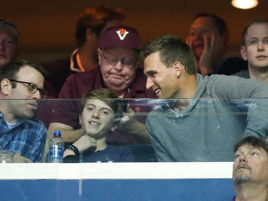 Kirk Cousins, right, watches the first half between LSU and Michigan State, March 29, in Washington, D.C.