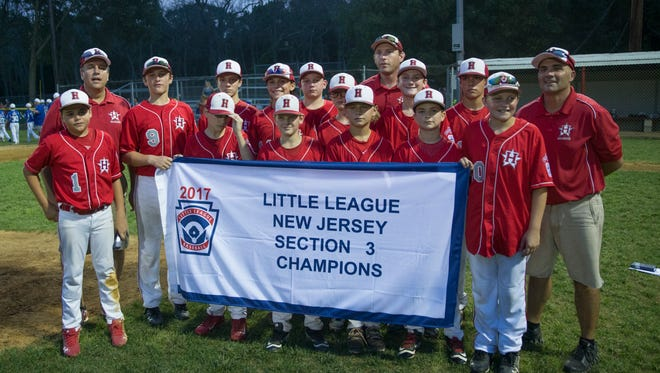 Holbrook with their winning banner. Holbrook vs Sayreville in Little League Section 3 Tournament final in Hamilton, NJ on July 21,2017.