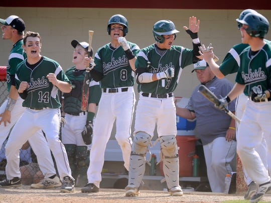 Parkside's Hunter Parsons, #14, Dalton Swanger, #14, Brady Shreeves, #8, Jack Goertsen, #7, and Nick Forbush, #1, celebrate after Matt Smith, #24 (obscured) scored to give Parkside a 1-0 lead against Poolesville in the third inning of a Class 2A state semifinal baseball game Tuesday, May 20, 2014 in Silver Spring. Parkside won 5-4 in nine innings.