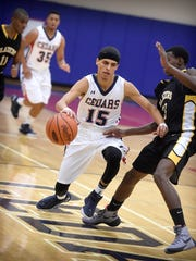 The Lebanon Cedars came out running to defeat Lancaster Mennonite 69-56 in the opening night of the 17th Annual Lebanon Athletic Booster Tip-Off Tournament Friday, Dec. 4. Senior Matthew Lopez (15) drives past Blazer Ezra Buckwaiter (3).